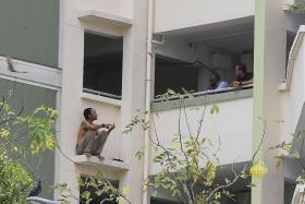Man arrested after perching on ledge in Yishun Ring Road