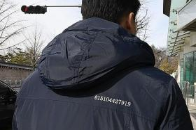 S. Korea officials don coats with message to North's Kim