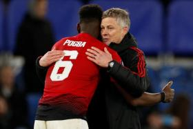 Ole Gunnar Solskjaer has praised Paul Pogba for toning down his off-field behaviour.
