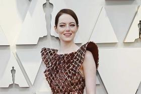 Emma Stone slinks to success at Oscar red carpet