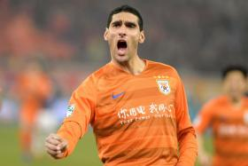 Marouane Fellaini celebrates after scoring the winner for his new club Shandong Luneng.