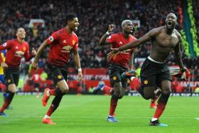 Romelu Lukaku (far right) leads the celebrations after completing Manchester United's comeback 3-2 win.