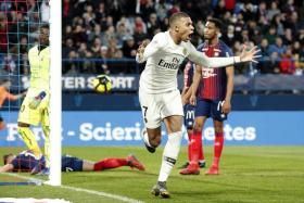 Kylian Mbappe celebrating after making it 2-1 against Caen.