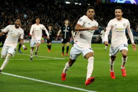 Marcus Rashford leads the celebrations after scoring their late penalty.