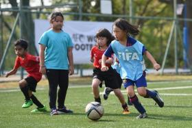 About 100 girls having fun at the Girls' Fun Football Carnival organised by the FAS.