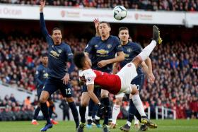 Arsenal's Pierre-Emerick Aubameyang attempting an acrobatic kick.