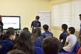 Saffareeszan Ghaniman Abdullah presenting to his team as one of the sub-committees in-charge for YouthCOP camp.