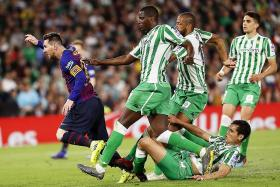 Messi hat-trick blows away Betis supporters