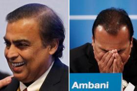 Mukesh Ambani (left) and Anil Ambani.