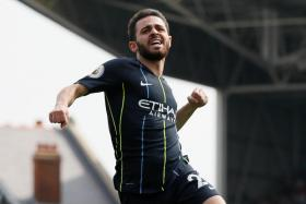 Bernardo Silva celebrates after scoring Manchester City's first goal in their 2-0 win over Fulham.