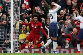 Mohamed Salah celebrates after an own goal by Toby Alderweireld gives Liverpool a 2-1 lead.