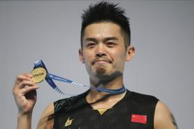 Lin Dan showing his Malaysia Open winner's medal with pride.
