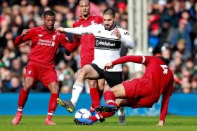 The Liverpool backline (in red) has presided over a solitary defeat and shipped just 20 goals in 33 EPL games.