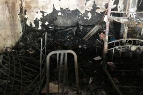 Four rescued after PMD fire guts Woodlands flat