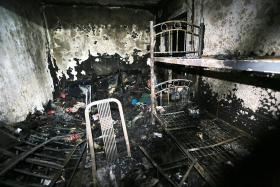 Resident trapped in Woodlands flat after fire starts in nearby unit