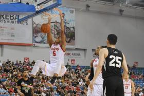 John Fields (slam-dunking against the Macau Black Bears in the quarter-finals) is often the most demonstrative player, waving at the crowd after a big dunk and shouting encouragement at his teammates.