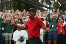 Tiger Woods letting out a roar of victory after clinching his fifth US Masters title, at the age of 43.
