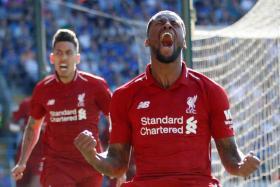 Georginio Wijnaldum lets out a roar after scoring Liverpool's first goal of a corner-kick routine.