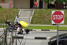 The pedestrian, a 16-year-old student, resting his head on a classmate's lap while waiting for the ambulance.