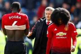 Manchester United's Paul Pogba, Ole Gunnar Solskjaer and Tahith Chong look disappointed after their 1-1 draw with Huddersfield.