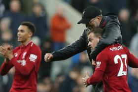 Liverpool manager Juergen Klopp giving substitute Xherdan Shaqiri a hug after their 3-2 win over Newcastle.