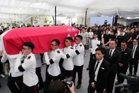 A state flag draped over the casket of late actor Aloysius Pang during his militart funeral.