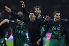 Mauricio Pochettino celebrates his players after a successful comeback against Ajax.