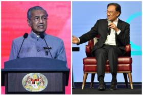 Prime Minister Mahathir Mohamad (left) will take on the role of a statesman after PKR president Anwar Ibrahim (right) takes over the country's reins.