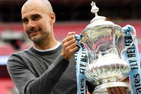 Pep Guardiola has led Manchester City to an unprecedented English treble.