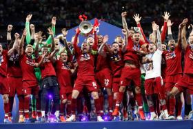 A buoyant Liverpool squad celebrate after winning the Champions League.
