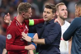 Tottenham manager Mauricio Pochettino (right) congratulating  Liverpool skipper Jordan Henderson.