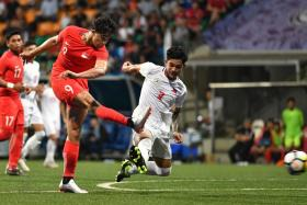 Singapore striker Ikhsan Fandi attempting a shot at goal against the Philippines.