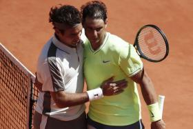 Rafael Nadal receives congratulations from Roger Federer after the French Open semi-final.