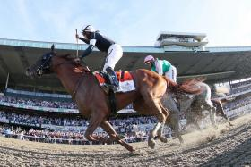 Sir Winston winning the 151st Belmont Stakes yesterday (Singapore time).
