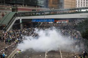 HK cops fire rubber bullets as protests turn violent