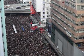 Hundreds of thousands clog HK streets to demand leader resign