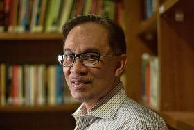 Writer who wrote book on Anwar says he did blackmail PKR chief