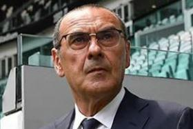 Maurizio Sarri in a Juventus team suit and tie during his unveiling as the Italian giants' coach yesterday.