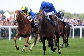 Jockey James Doyle driving the favourite Blue Point (in blue) to take the Diamond Jubilee Stakes over 1,200m at Royal Ascot, England, on Saturday.