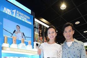 Joanne Peh helps protect hubby's skin from the sun