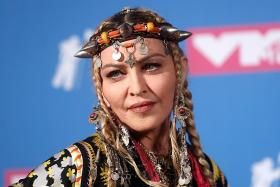 Madonna releases wake-up call on gun violence in graphic music video