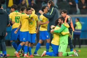 Brazil players celebrate after reaching the Copa America semi-finals.