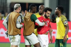 Mohamed Salah getting consoled by South African players after Egypt's exit
