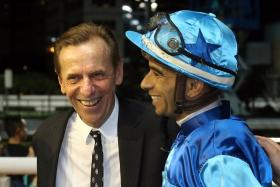The formidable combination of trainer John Size (left) and jockey Joao Moreira struck twice at Happy Valley on Wednesday night to keep Size two winners ahead of John Moore, with only Sunday's race meeting left to the Hong Kong season.
