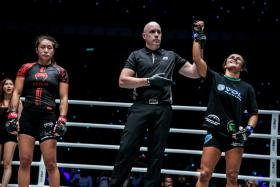 Michelle Nicolini (right) wins her strawweight bout against Angela Lee by unanimous decision.