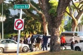9 men arrested after angry confrontation at Duxton Hill