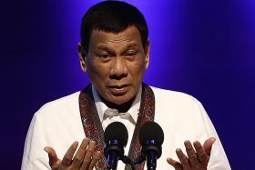 Philippine President says he won't be tried by international court