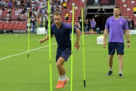 Christian Eriksen training alone at the National Stadium on Friday (July 19).