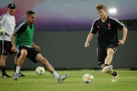 Matthijs de Ligt (right) taking part in his first training session with Juventus at the Bishan Stadium on Saturday.