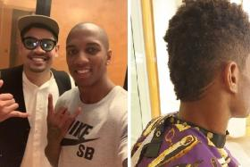 Local barber Muhammad Khairi (left) with his clients Ashley Young and (far right) Marcus Rashford.